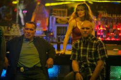Arnold Schwarzenegger, Mireille Enos and Sam Worthington in Sabotage