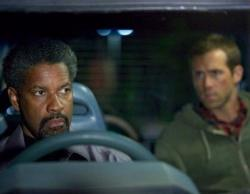 Denzel Washington schools Ryan Reynolds in Safe House.
