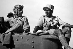 Humphrey Bogart and Rex Ingram in Sahara.