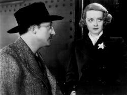 Warren William and Bette Davis in Satan Met a Lady.
