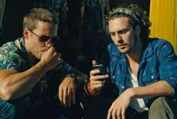 Taylor Kitsch and Aaron Taylor-Johnson in Savages.