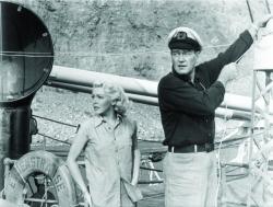 Lana Turner and John Wayne in The Sea Chase.
