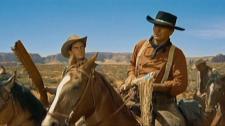 Jeffrey Hunter and John Wayne.