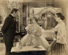 Mary Pickford wears an elaborate Adrian gown.
