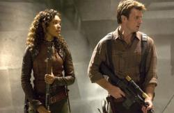 Gina Torres and Nathan Fillion in Serenity.