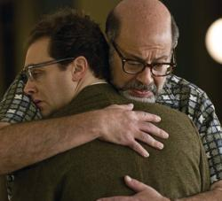 Larry Gopnick gets a big bear hug from Sy Ableman, his wife's boyfriend in A Serious Man.