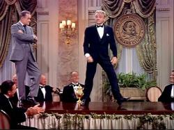 Bob Hope watches James Cagney dance in The Seven Little Foys.