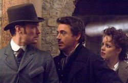 Jude Law, Robert Downey Jr. and Rachel McAdams as Dr. Watson, Sherlock Holmes and Irene Adler.