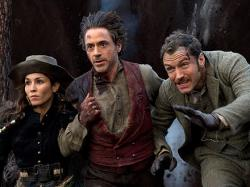 Noomi Rapace, Robert Downey Jr. and Jude Law in Sherlock Holmes: A Game of Shadows.