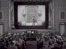 Buster Keatons walks into the movie in Sherlock Jr.