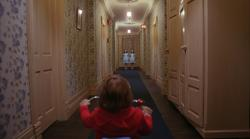 Danny Lloyd meets the ghosts of the little girls in The Shining.