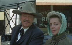 John Wayne and Lauren Bacall in The Shootist.