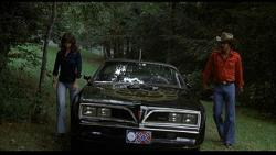 Sally Fields, the Pontiac Trans-Am and Burt Reynolds in Smokey and the Bandit.