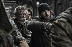 John Hurt and Chris Evans in Snowpiercer.