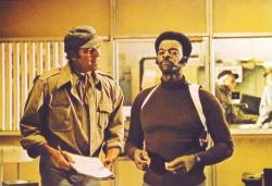 Charlton Heston and Brock Peters wearing very 1970s attire in the supposedly futuristic Soylent Green.
