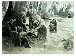 Mary Pickford as Molly leads orphans through a swamp in Sparrows.