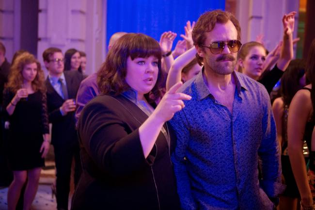 Melissa McCarthy and an in-disguise Jason Statham in Spy.