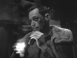 William Holden in his Oscar winning performance as Sefton in Stalag 17.