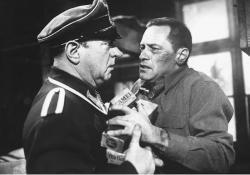 Sgt. Schulz (Sig Ruman) and Sgt. Sefton (William Holden) in Stalag 17