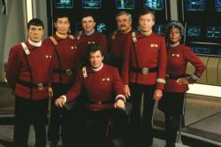 The seven iconic crewmembers of the Starship Enterprise in Star Trek V: The Final Frontier.