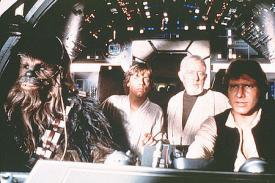 Peter Mayhew, Mark Hamill, Alec Guiness and Harrison Ford in Star Wars.