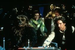 Peter Mayhew, Carrie Fisher, Anthony Daniels, Mark Hamill and Harrison Ford in Star Wars: Episode VI Return of the Jedi.