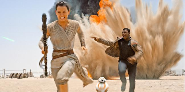Daisy Ridley and John Boyega in Star Wars: The Force Awakens.