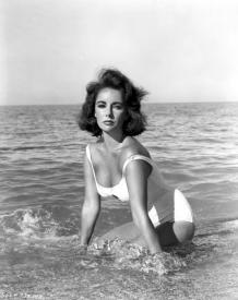 The ravishing Elizabeth Taylor enjoys the surf in Suddenly, Last Summer.