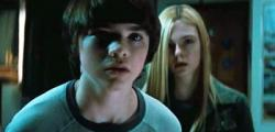 Joel Courtney and Elle Fanning having one of many dramatic conversations in Super 8.