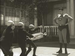 John T. Bambury, Tony Boris, Billy Curtis, and George Reeves in Superman and the Mole Men.