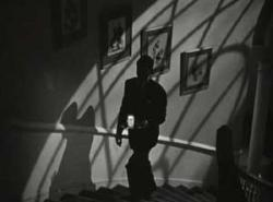 Cary Grant keeps to the shadows in Alfred Hitchcock's Suspicion.