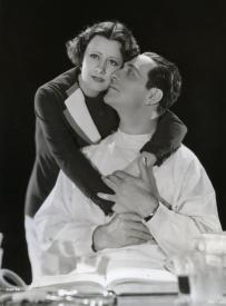 Irene Dunne and Ricardo Cortez in Symphony of Six Million.