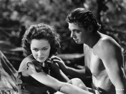 Maureen O'Sullivan and Johnny Weissmuller as Jane and Tarzan.