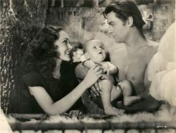 Maureen O'Sullivan, Johnny Weissmuller and baby makes three in Tarzan Finds a Son.