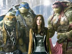 Megan Fox and some CGI covered actors in Teenage Mutant Ninja Turtles