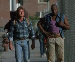 Roddy Piper and Keith David in They Live.