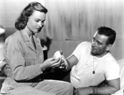 Donna Reed nurses John Wayne.