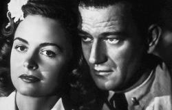 Donna Reed and John Wayne in They Were Expendable.
