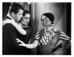 Lyle Talbot, Ann Dvorak and Joan Blondell in Three on  a Match.