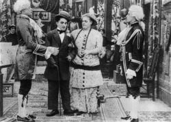 Charlie Chaplin and Marie Dressler dealing with the hired help in Tillie's Punctured Romance