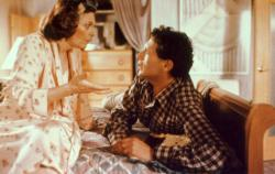 Ann Bancroft and Harvey Fierstein in Torch Song Trilogy. You cannot see them in this picture but Bancroft is wearing bunny slippers.