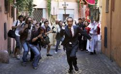 Roberto Benigni gets chased by papparazi in Woody Allen's To Rome with Love.