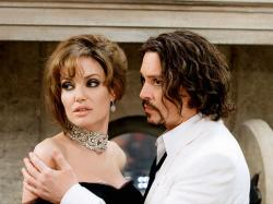 Jolie looks dolled up, while Depp needs to clean up.