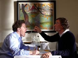 Steve Coogan offers Rob Brydon a bite of his dessert in The Trip.