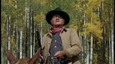 John Wayne as Rooster Cogburn right before his famous shootout on horseback.