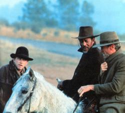 Jaimz Woolvett, Morgan Freeman and Clint Eastwood in Unforgiven.