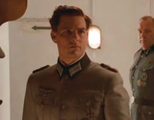 Tom Cruise as Colonel Claus von Stauffenberg, after he lost his eye, but with his glass eye in place, instead of his eye-patch.