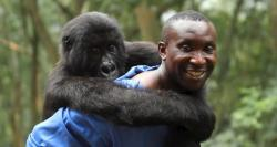 Andre Bauma and one of his children in Virunga