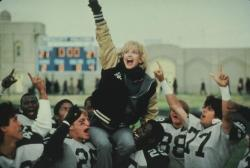 Goldie Hawn on the shoulders of Woody Harrelson and Wesley Snipes in Wildcats.