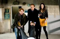 Rupert Grint, Bill Nighy, and Emily Blunt in Wild Target.